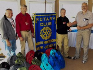 Tony, Ken, Ray and President Jim Murray at annual Clinton Rotary Club backpack drive meeting.