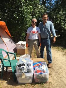 Ray and Rev. Steve with cartons of new summer clothing.