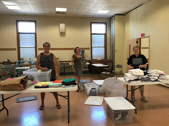 OCO RI Christ The King Parish Social Action Committee Sorting Packing For Deliveries