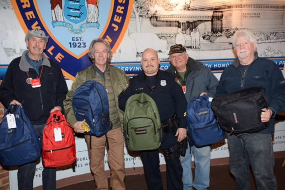 Sayreville Police department launches network of support for area homeless veterans. OPERATION CHILLOUT team delivering emergency rescue backpacks to Officer Tom Calise for their outreach initiative. L to R Ken Steffan, Deacon Ray Chimileski, Tom Calise, Maj. Tony De Stefano and Kevin Ruane. Not pictured Detective Chris Engelbrot and Det. Jeremy Berry.