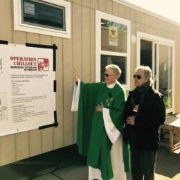 Fr Mike Drury blesses our first homeless vets tiny home over veterans day weekend at St Luke Church open house tour in Long Valley